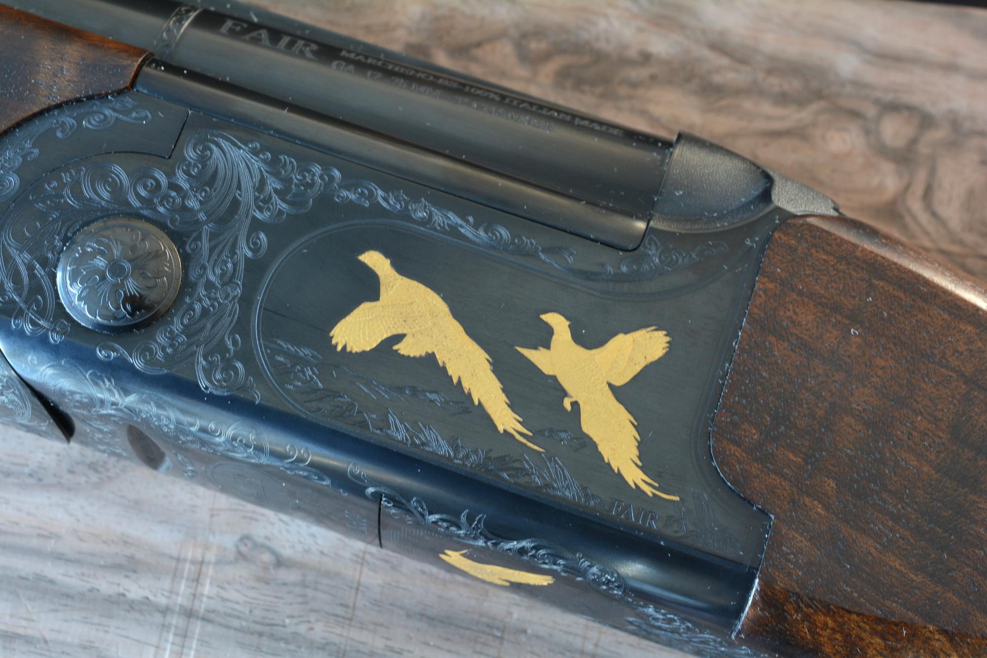 incisioni di fagiani sulla bascula del fair slx 600 de luxe black